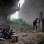 PHOTOS: This man educates India's poorest children in a school under a bridge — for free