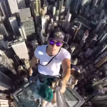 VIDEO: Three teens climbed to the top of a Hong Kong skyscraper and took this insane selfie