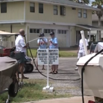 VIDEO: Scientologists show up at a guy's home to harass him, so he turns the hose on them
