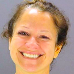 This woman is smiling because the yoga studio she set on fire was 'the Devil's temple'