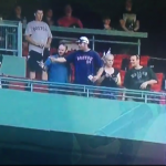 Red Sox fan pukes on people's heads below while his bros watch in paralyzed awe
