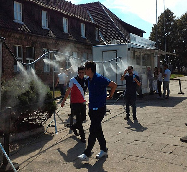 "Pic shows: The showers sprayed a special fine mist of water in order to help visitors of the Auschwitz concentration camp museum cool off. Polish managers of the Auschwitz concentration camp museum have been accused of insensitivity after putting up cold showers at the entrance to help visitors cool off. The showers sprayed a special fine mist of water in order to help visitors cool off but for many visitors it had the opposite effect. The move resulted in angry complaints to management led by a group of Israeli visitors over the weekend who said that anyone who saw the showers could not help get past the gas chamber connotation. Meyer Bolka, an Israeli visiting the museum, told local media: ""As soon as I got off the bus I walked into the shower contraption. I was in shock. It was a punch to the gut. I walked up to the reception and asked the worker there about the showers, she said it was a hot day."" He said as a Jewish person being sprayed with a shower when turning up at the Auschwitz concentration camp was a shock and it was a clear reminder for him of the horrors of the gas chamber. He added that while some of the young Israeli visitors did not seem to be bothered by the location of the mist showers, and had even used them, older visitors had been very angry. He said: ""I think that in a place like this they should have thought about the type of connotation this would raise. If you want to cool the people down, you need to find another solution. It was not a pleasant sight to see those sprinklers."" Auschwitz museum management meanwhile have issued a statement saying they didn't mean to cause any offence, and that the showers had been introduced for the comfort of visitors on what was supposed to be the hottest day of the year. However they have arranged a panel to review the location of the showers for future visitors. (ends)"