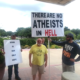 A Christian protester's sign didn't quite convey the message he intended.